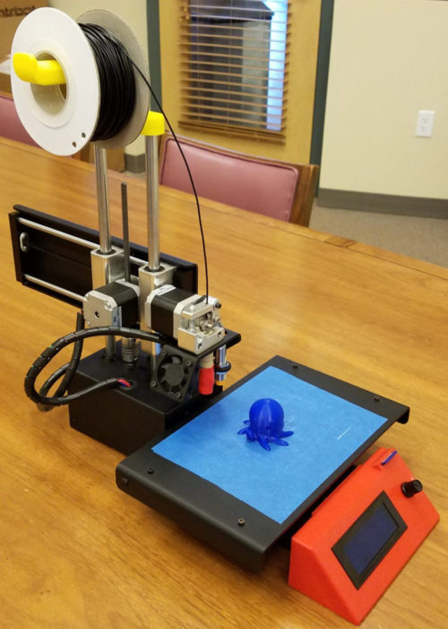 A picture of a 3-D printer sitting on a table