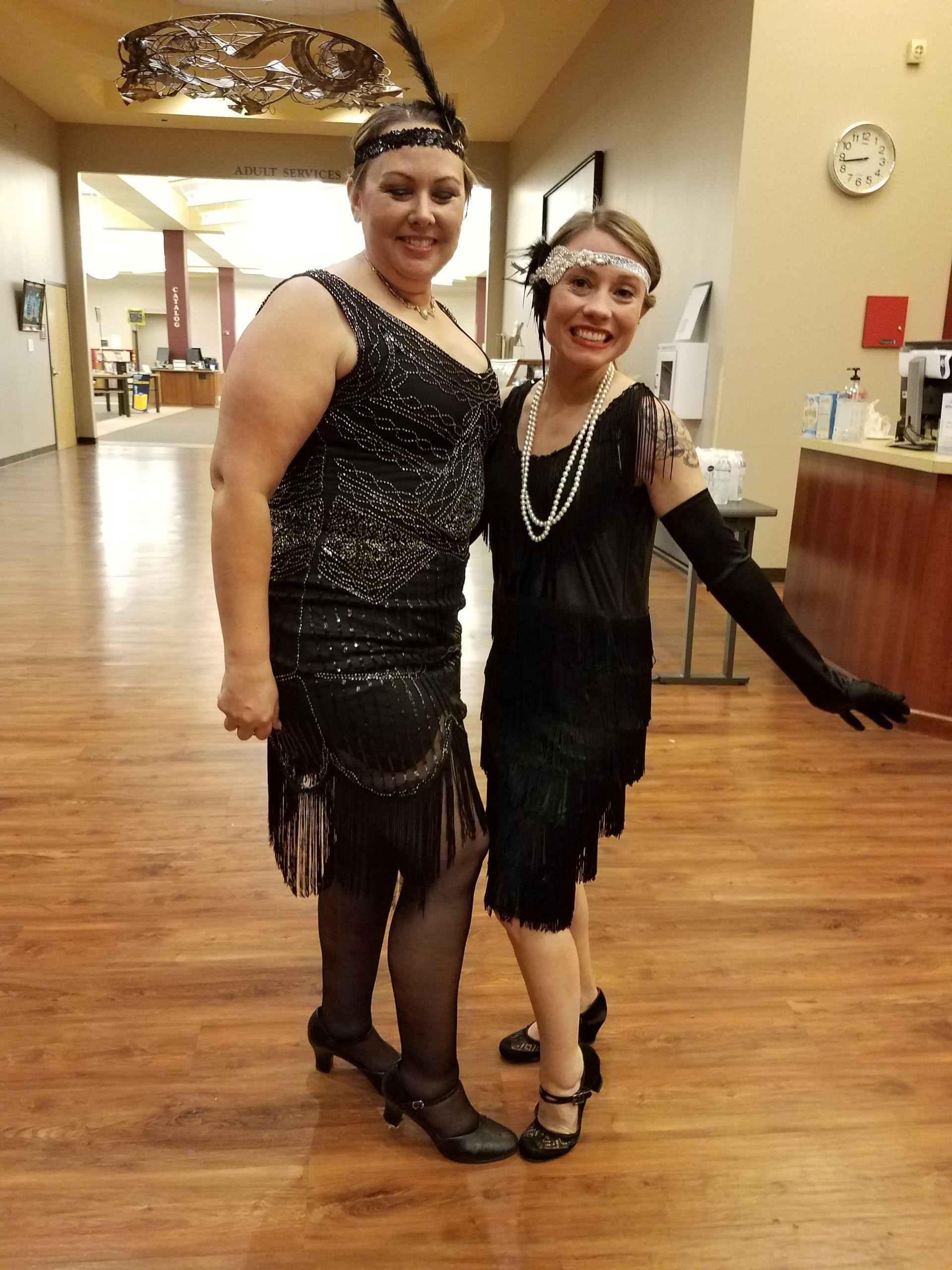 Photo of two women dressing in 1920s costumes