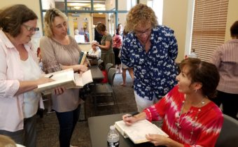 Author Lisa Wingate signs a book for a patron